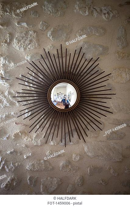 Decorative mirror mounted on wall