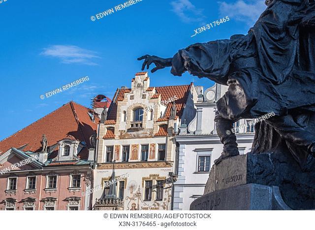 Humorous photo of sculpture pinching building in Prague - Czech Republic