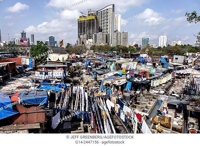 India, Asian, Mumbai, Mahalaxmi, Dhobi Ghat, Dhobighat, hanging, laundry, open air laundromat, outdoor, high rise modern condominium apartment building...