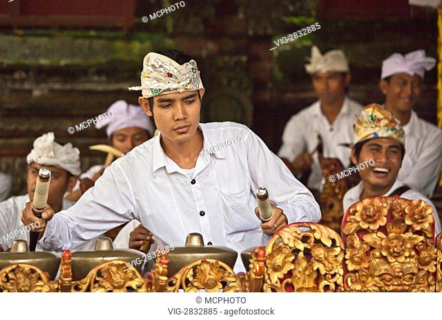 A BALINESE musician plays a GAMELAN at the temple of PURA BEJI in the village of Mas during the GALUNGAN FESTIVAL - UBUD, BALI, INDONESIA - 17/12/2010