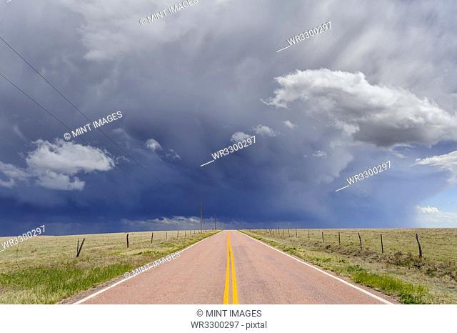 Storm clouds over open road, Rush, Colorado, United States