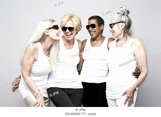 Studio portrait of senior women friends having fun