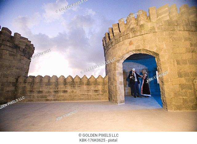 View of a navy officer and a princess standing in a castle turret