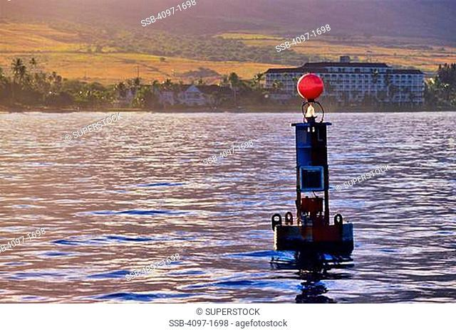Buoy with old whaling town in the background, Lahaina, Maui, Hawaii, USA