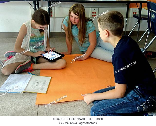 6th Graders Working on Social Studies Lesson, Wellsville, New York, United States