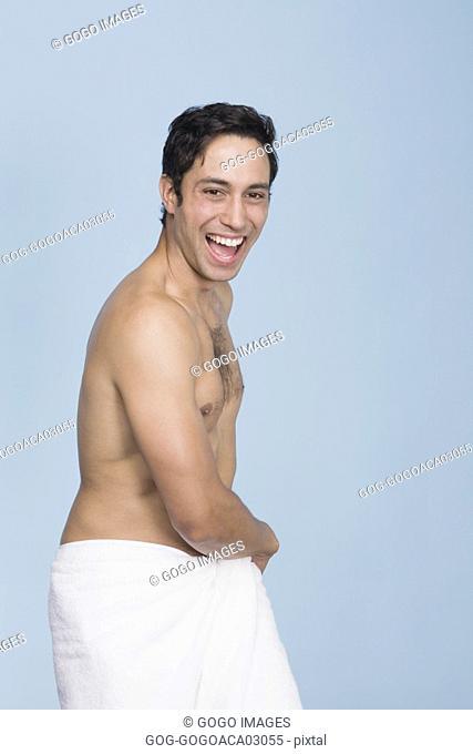 Man wrapping towel around himself