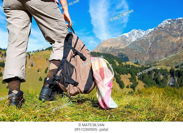 A female hiker in the swiss alps; San Bernardino, Grisons, Switzerland