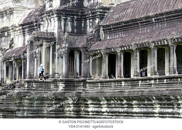 Tourist in Angkor Wat Temple, Angkor Temple Complex, Siem Reap Province, Cambodia, Asia, UNESCO. It was originally constructed as a Hindu temple dedicated to...
