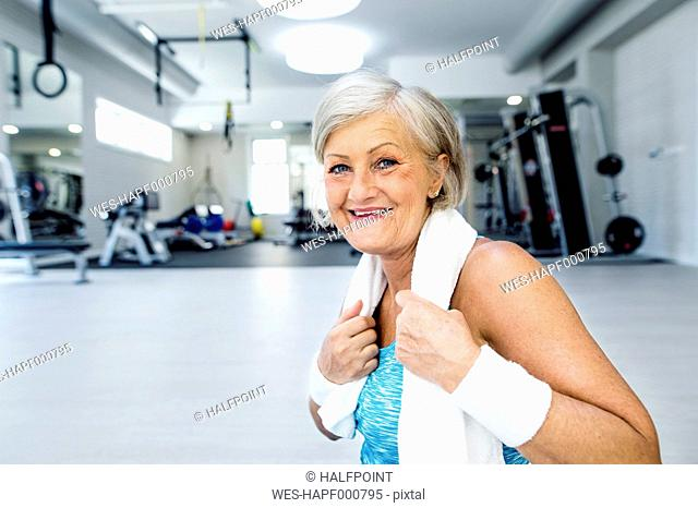 Portrait of smiling mature woman in fitness gym