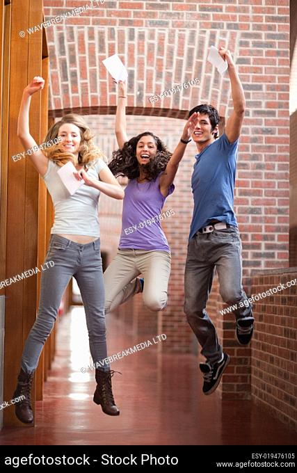Portrait of successful students jumping