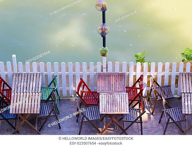Wooden tables and chairs by the river Tiber (Tevere), Rome, Lazio, Italy, Europe