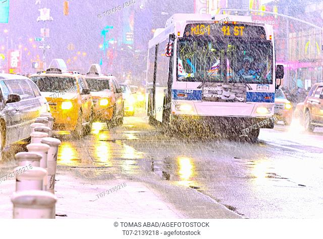 MTA M104 bus, public transportation, mass transit, Times Square during January 2, 2014 winter storm, 42nd Street vicinity, Times Square, Midtown Manhattan