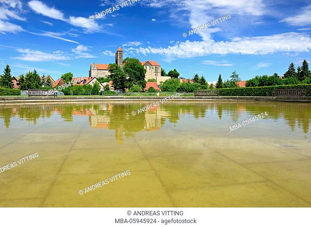 Germany, Saxony-Anhalt, Quedlinburg, The castle hill with collegiate church of St. Servatius is reflected in the water of a pond in the abbey garden