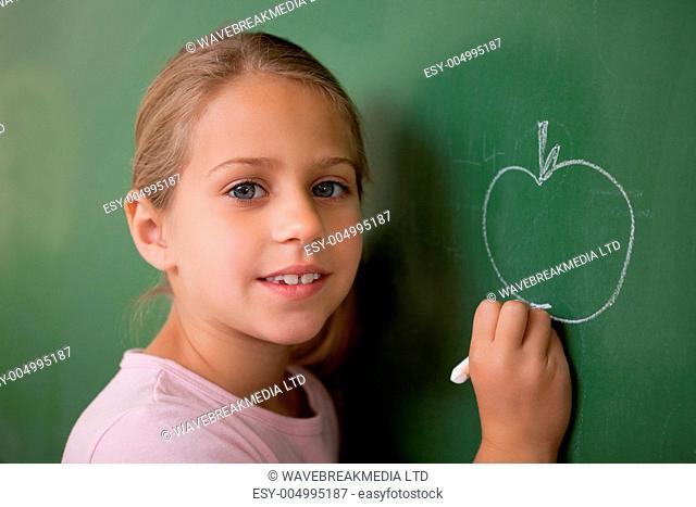 Schoolgirl drawing an apple