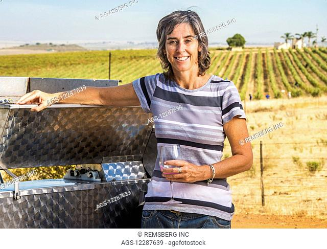 Wine maker mashing wine grapes; Paarl, Western Cape, South Africa