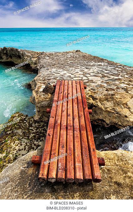 Wooden bridge across rocks on the coastline