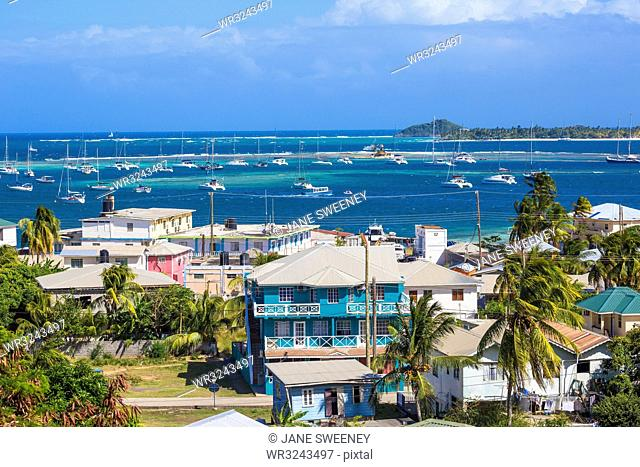 View of Clifton and Clifton harbour, Union Island, with Palm Island in the distance, The Grenadines, St. Vincent and The Grenadines, West Indies, Caribbean