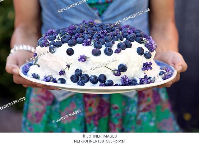 Woman holding blueberry cake
