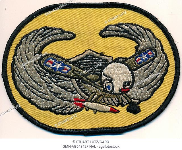United States Air Force aviator patch, from the Vietnam War era, showing an eagle holding a missile with the United States Air Force insignia on its wings, 1964