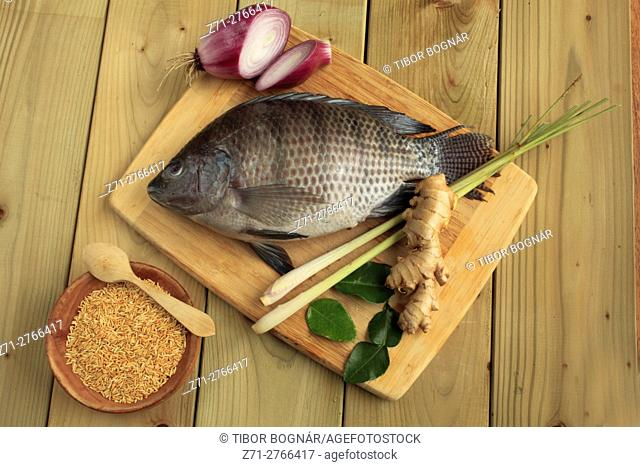 Lao fish salad, ingredients: tilapia fish, kaffir lime leaves, onions, ginger, lemon grass, rice,