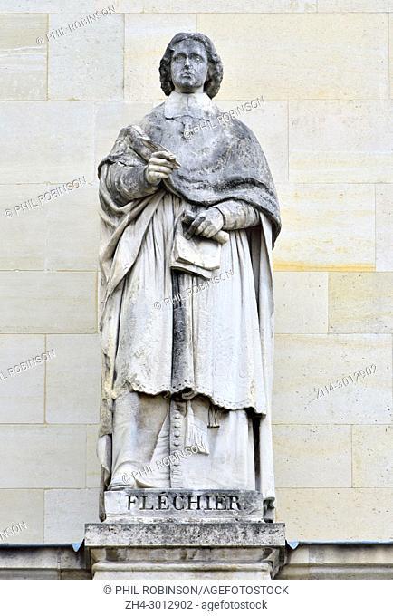 Paris, France. Palais du Louvre. Statue in the Cour Napoleon: Esprit Fléchier (1632 - 1710) French preacher and author, Bishop of Nîmes from 1687 to 1710