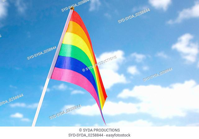 close up of gay pride rainbow flag over blue sky