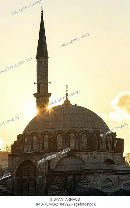 Turkey, Istanbul, historical centre listed as World Heritage by UNESCO, Eminonu district, mosque and minaret at sunset against the light