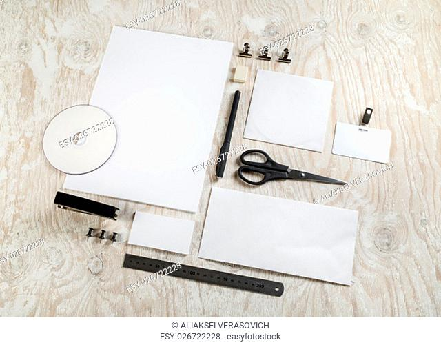 Photo of blank stationery on light wooden background. ID template. Mockup for branding identity for designers. Top view