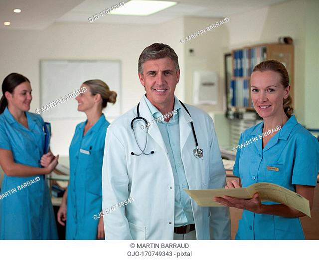 Doctor and nurse reviewing medical chart