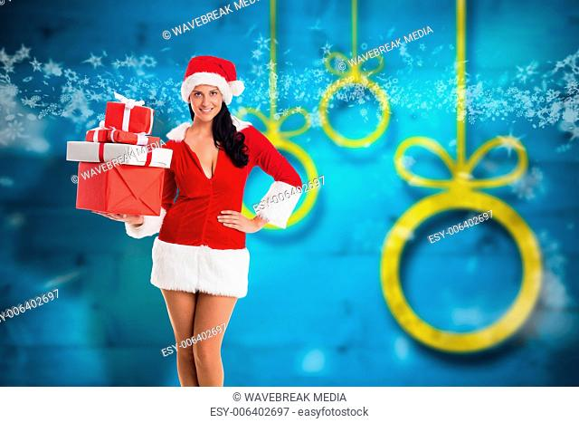 Composite image of woman smiling with christmas presents
