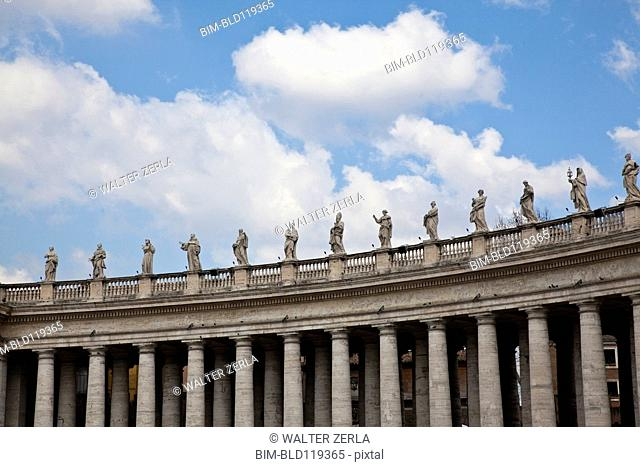 Statues on columned building, Roma, Vaticano, Italy