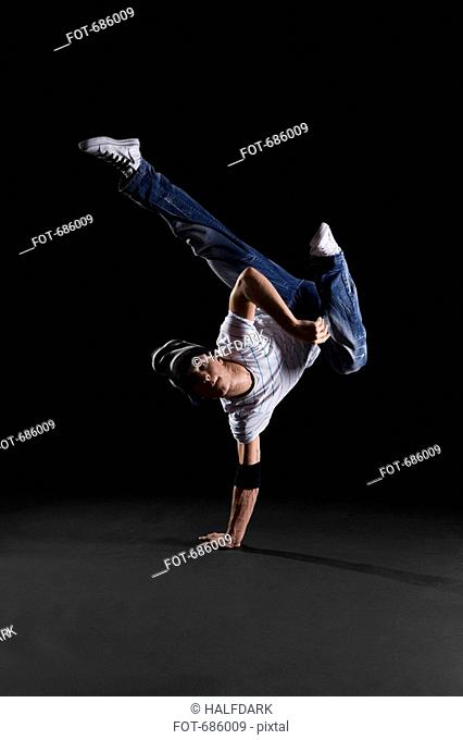 A B-boy doing a K-Kick breakdance move