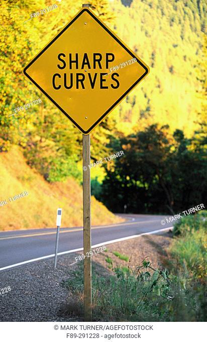 'Sharp curves' sign along Evans Creek Road. Jackson County. Oregon, USA