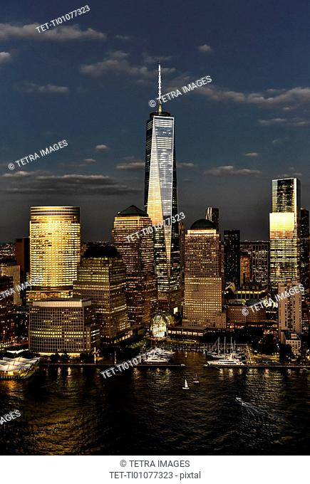 Aerial view of city with Freedom tower at night