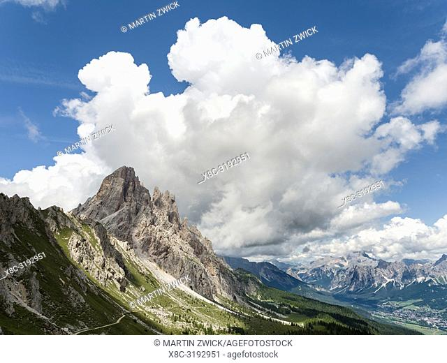 Thunderstorm clouds over the summits of Croda da Lago in the Dolomites of the Veneto near Cortina d'Ampezzo. Part of the UNESCO world heritage
