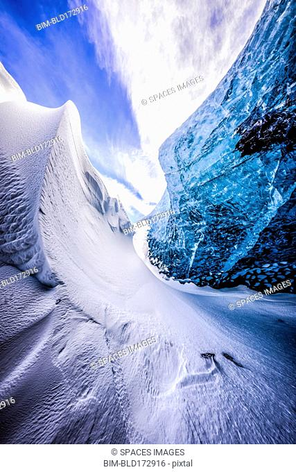 Glass wall of snowy ice cave