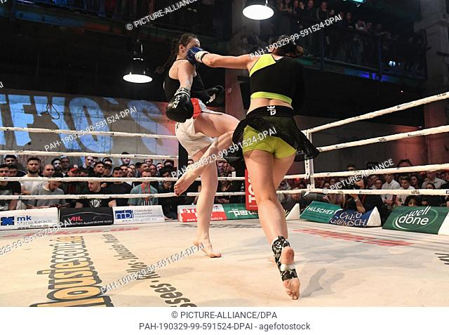 28 March 2019, Bavaria, München: The kickboxers Marie Lang (r) and Aleksandra Sitnikova fight at Stekos Fight Club in Mixed Munich Arts