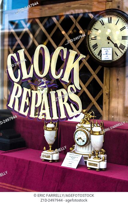 Clock repairs business. Shop window Salisbury England UK