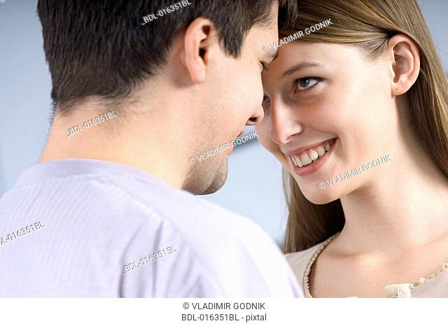 portrait of young couple tenderly looking at each other