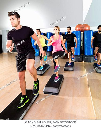 Cardio step dance people group at fitness gym training workout