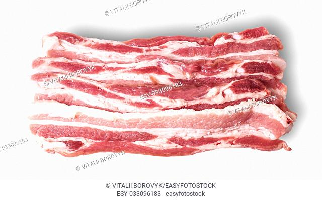 Several pieces of bacon stacked in layers isolated on white background