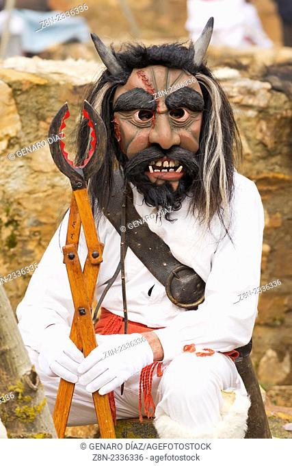 warrior jurru with wooden tongs in carnival of Alija del infantado, Leon, Spain