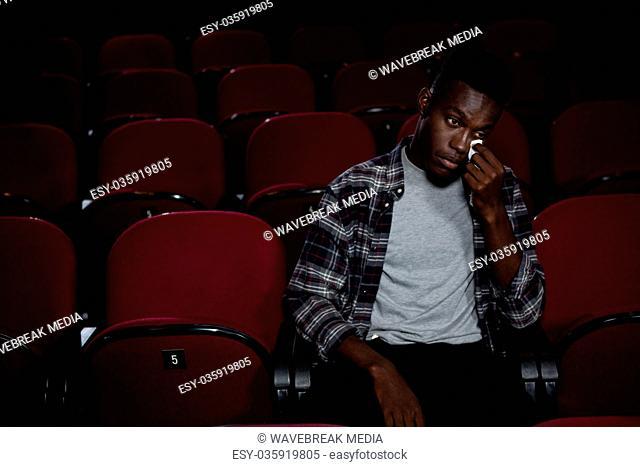 Man getting emotional while watching movie