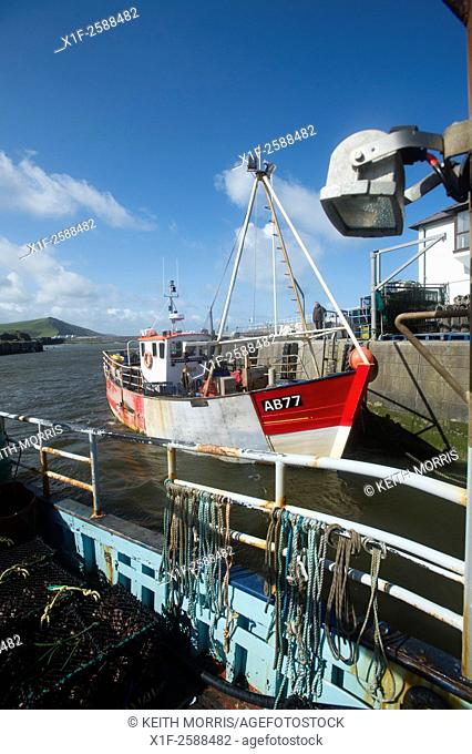 Inshore fishing in Cardigan Bay : a small lobster and crab fishing boat working out of Aberystwyth harbour, Ceredigion west Walesd UK