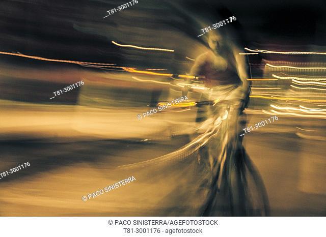 Night cyclist in motion. Valencia, Spain
