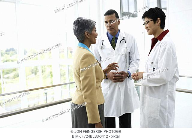 Doctors talking to businesswoman