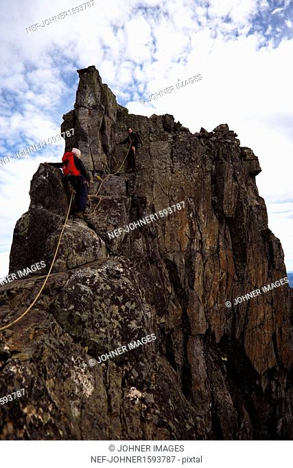 Man and woman climbing