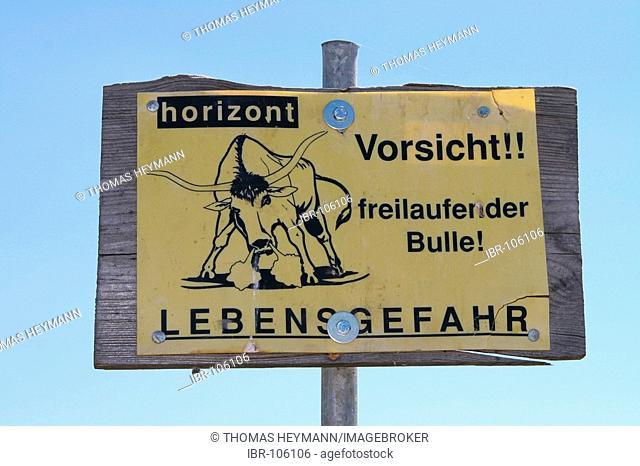 Signpost caution bull serious danger