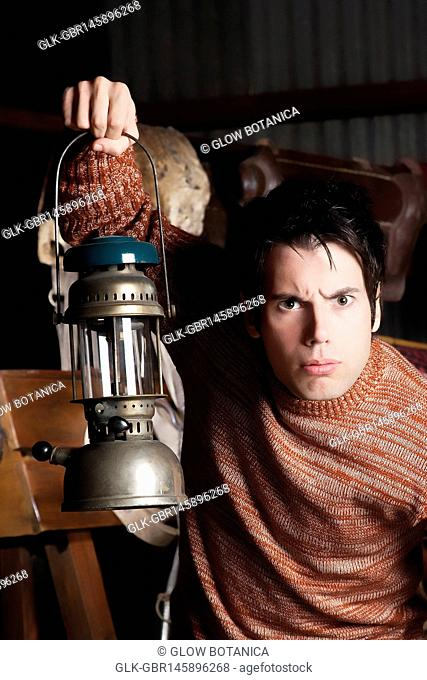 Portrait of a man holding a lantern