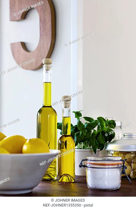 Olive oil and lemons in domestic kitchen